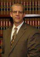 Kevin E. Warren