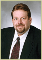 Chris A. Barker: Attorney with Barker & Cook, P.A.